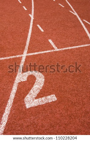 Number two on the start of a running track