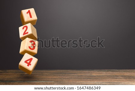 Numbered blocks on top of each other in an unstable tower. Alternate items and conditions for implementation. Contract road map. Organization and systematization, step by step instructions. Order Stock photo ©