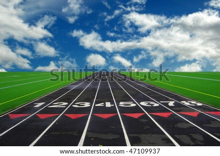 Numbered lanes on a mile running fitness athletic black track.
