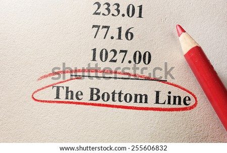 numbers and pencil with The Bottom Line circled                                #255606832