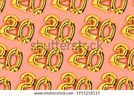 Numbers 20 golden balloons pattern. Twenty years anniversary celebration layout on a coral background. Сток-фото ©