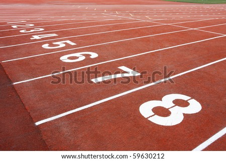 Numbers of track lanes in sports runway - stock photo