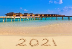 Numbers 2021 on beach - concept holiday background