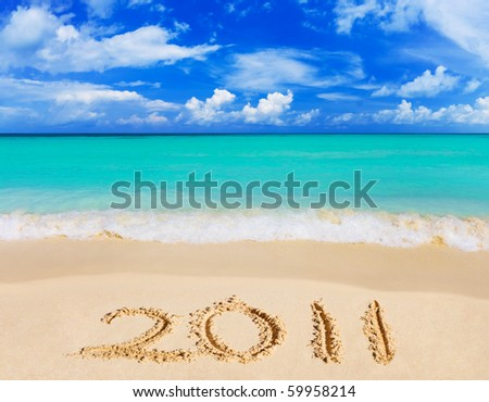 Numbers 2011 on beach - concept holiday background