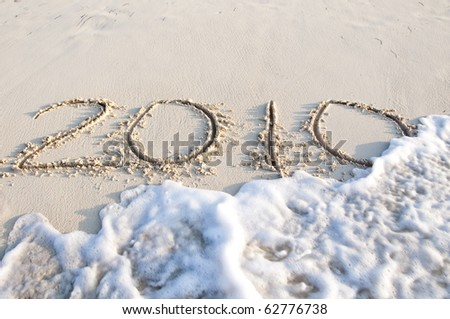 Numbers 2010 on sand beach - concept holiday background. Cuba