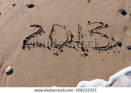 Numbers 2013 on the beach sand