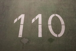 Numbers painted on concrete and asphalt textured surfaces