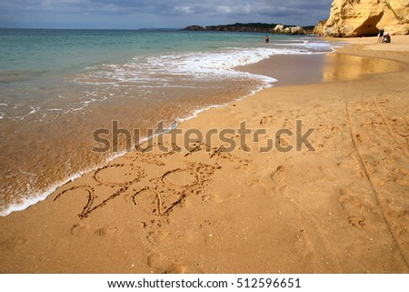 numbers written in the sand/ turn of the year/ numbers written in the sand on a beach #512596651