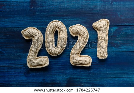 Numerals 2021 made of crochet handmade numbers. New year concept. Vision of new twenty twenty one logo Plastic numbers 2021 but white background. New Year 2021. Results of 2021. Concept