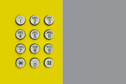 Numeric keypad of phone on the yellow background and have Gray Paper on the side for the design in technology backdrop.