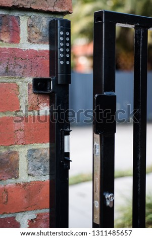 Numeric keypad on gate for secure access #1311485657