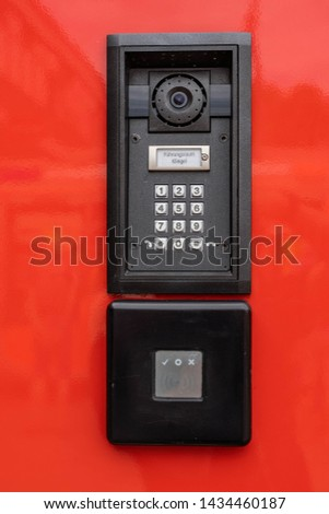 """Numeric keypad with camera module and RFDI sensor to access the high command space of a fire truck, German words """"Führungsraum Klingel"""" means """"lead room bell"""", lower pad shows checkmark, circle and X #1434460187"""