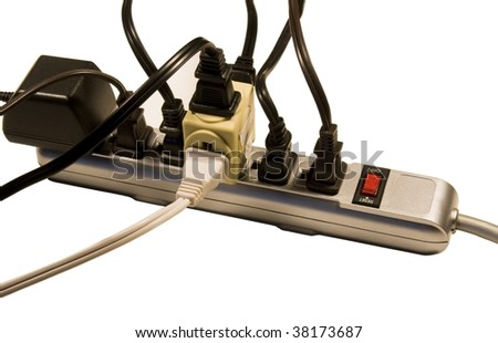 numerous cords and transformer plugged into a power strip