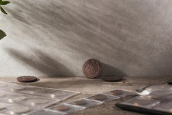 Numismatics. Old collectible coins made of silver, gold and copper on a wooden table. Copy space of your text.