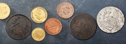 Numismatics. Old collectible coins made of silver, gold and copper on a wooden table. Top view.. Black backgraund. Banner.