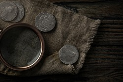 Numismatics. Old collectible coins of silver on the table. Top view.