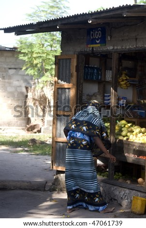 NUNGWI, ZANZIBAR - JANUARY 2: Local woman sells local produce in the village, January 2, 2010 in Nungwi, Zanzibar.