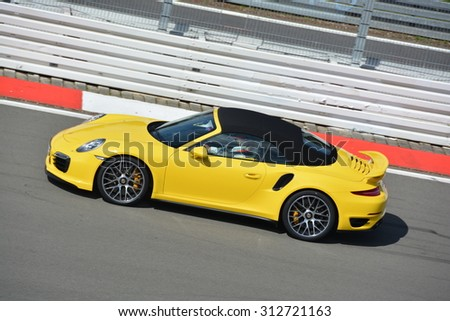 NURBURG, GERMANY - AUGUST 29: Swiss race car driver Neel Jani driving a Porsche for the VIP hot laps during round 4 of the FIA World Endurance Championship on August 29, 2015 at Nurburg, Germany.