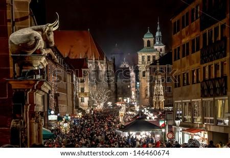 NUREMBERG, GERMANY - CIRCA DEC 2012 - Big crowds visit the Christmas Market at night circa December 2012 in Nuremberg. Annual \