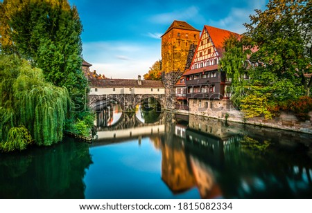 Nurnberg town river in Germany. City river water reflection view. River in city