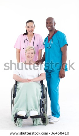 Nurse and doctor looking after a senior patient in a wheel chair