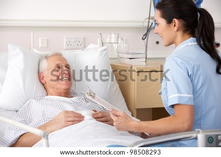 Nurse and male patient in UK Accident and Emergency