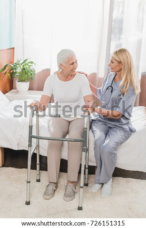 nurse and senior woman with...