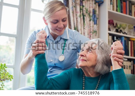 Nurse Assessing Stroke Victim By Raising Arms #745518976