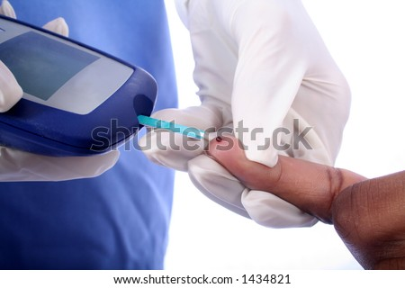 Nurse checking diabetic's blood sugar - stock photo