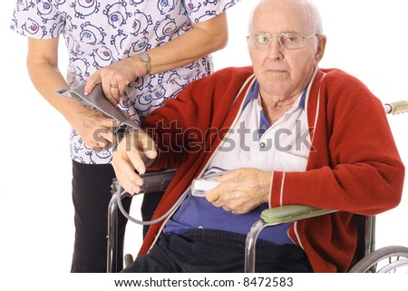 nurse checking elderly patients blood pressure