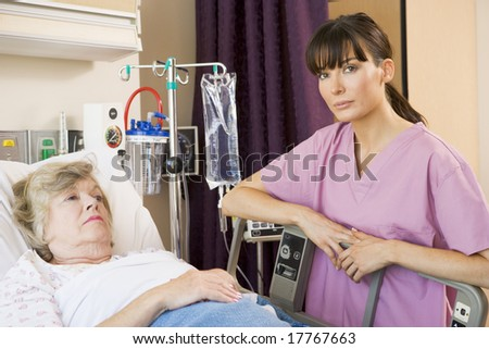 Nurse Checking Up On Patient