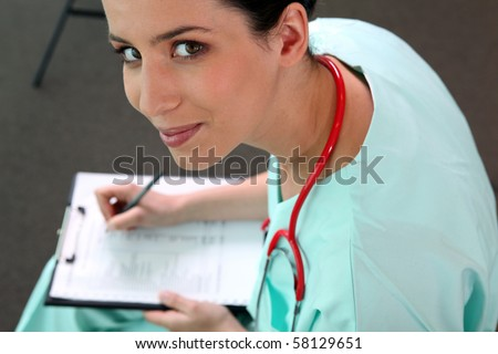 Nurse filling out medical files