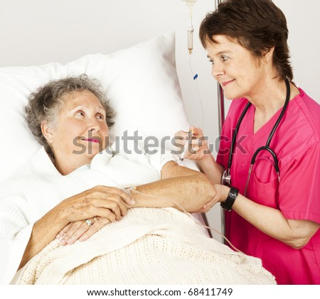 Nurse gives injection to an elderly hospital patient.