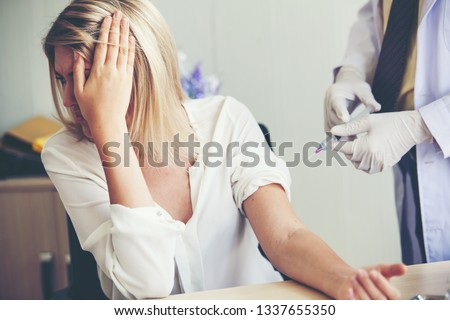 Nurse hand with syringe needle and woman fear of injections phobia concept against  Сток-фото ©