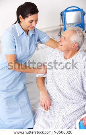 Nurse helping male patient in UK Accident and Emergency