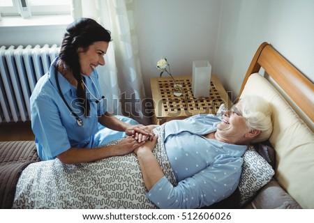 nurse interacting with senior...