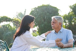 Nurse listening to heartbeat of old patient