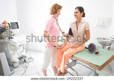 Nurse measuring the patient's blood-pressure.