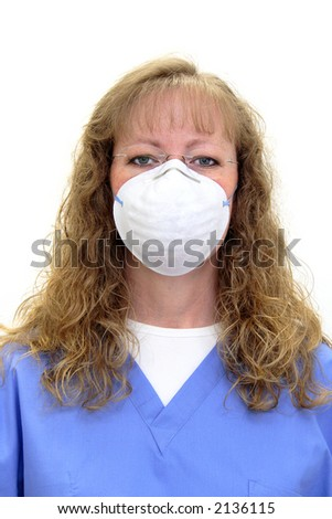 Nurse or dental hygienist in scrubs wearing a protective mask and eye glasses. Isolated on white.