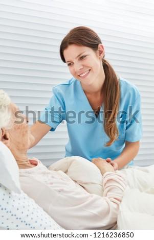 Nurse or nurse assisting a bedridden patient