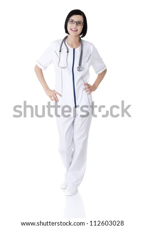 Nurse or young doctor standing smiling. Isolated on white background. Full body