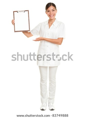 Nurse showing blank clipboard sign - a medical concept. Woman doctor / nurse smiling happy isolated on white background in full body. Mixed race Caucasian / Chinese Asian female model.