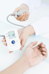 Nurse showing blood pressure indicator
