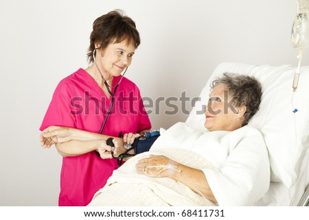 Nurse takes a senior patient's blood pressure in the hospital.
