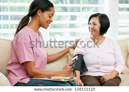 Nurse Visiting Senior Female Patient At Home