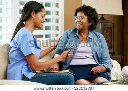 Nurse Visiting Senior Female Patient At Home