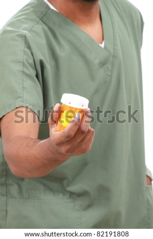 Nurse with a bottle of pills