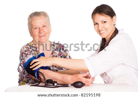 nurse with an old patient on a white