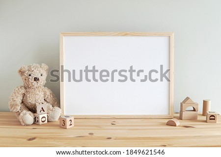Nursery frame mockup, empty wooden horizontal frame for baby room or kids room wall art, print, photo.