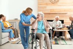Nurses assisting elderly people at retirement home